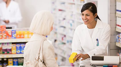pharmacy tech woman talking with a customer