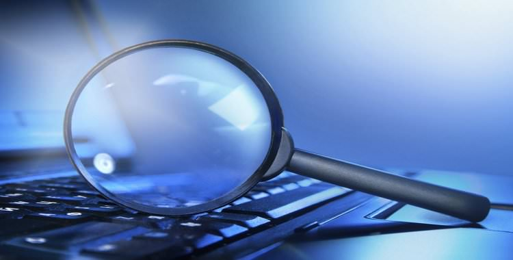 Magnifying glass on top of laptop