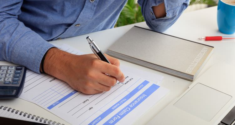 Man preparing an health Insurance Claim Form