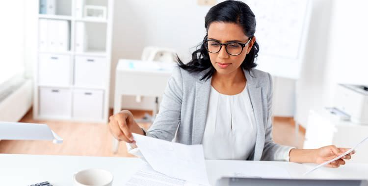 A Medical Administrative Assistant working-at-her-desk