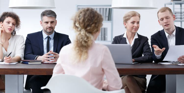 Law Firm examination board discussing resume