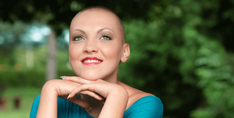 a cancer patient smiling in nature