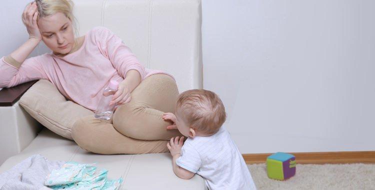 Postpartum Depression mother with her child