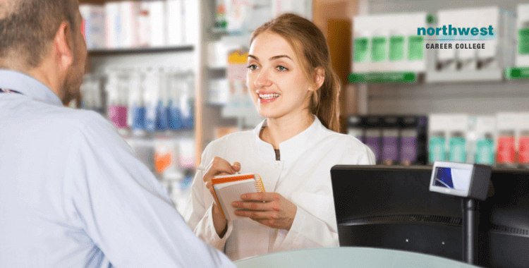 A woman pharmacy technician talking with a man