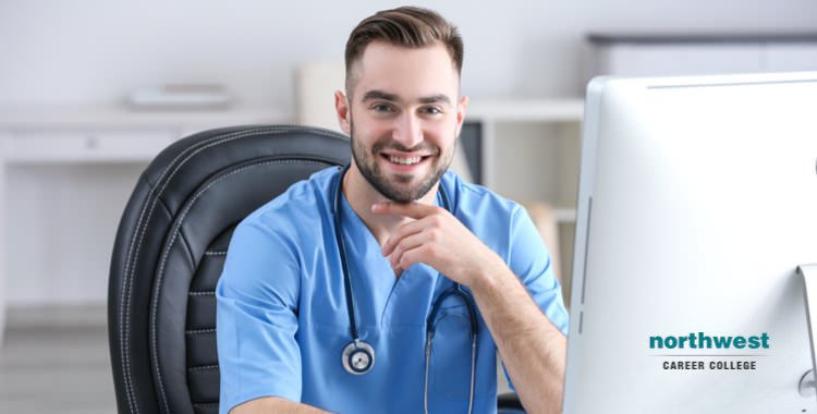 a medical assistant working on his desk