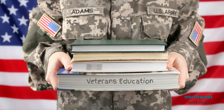 A female veteran holding books stacked on top of eachother in her arms.
