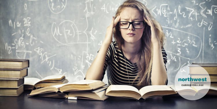 A young girl is studying but is very stressed out.