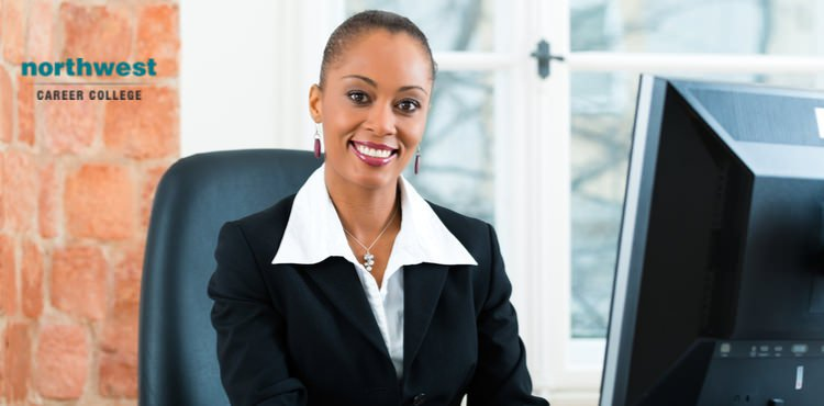 A female paralegal looking at the camera and smiling.