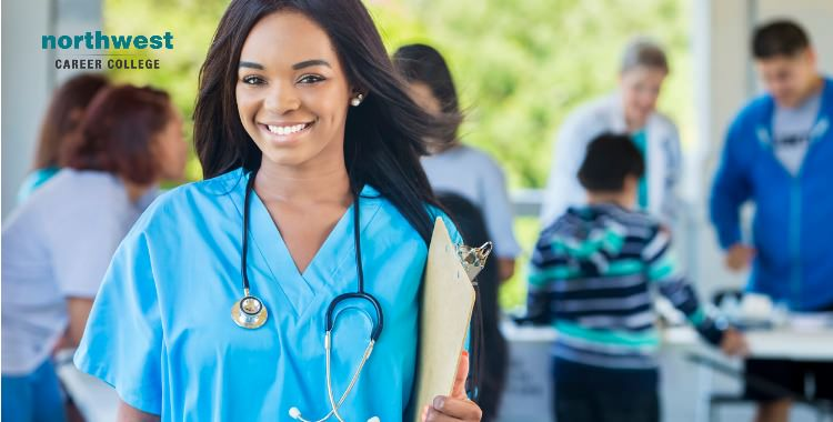 A female healthcare person with stethoscope around her neck and clipboard in her hand.