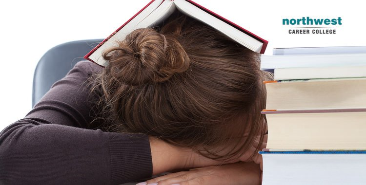 The Day Of An Exam, a woman sleeps with a book on her head.