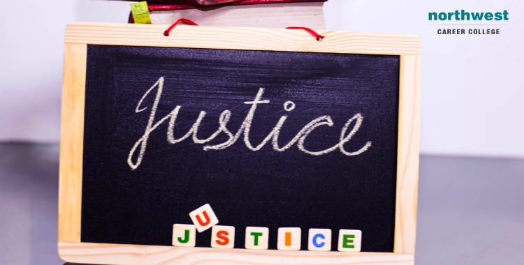 The word Justice written on a slate.