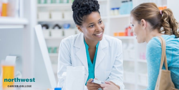 pharmacy technician talking with customers