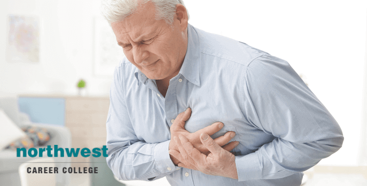 senior citizen clutching at his chest because he is having cardiac arrest