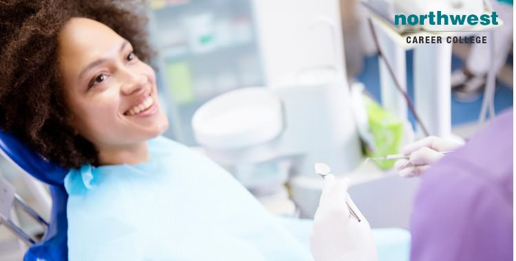 A woman looking at her dentist and smiling as she is about to undergo dental procedure.