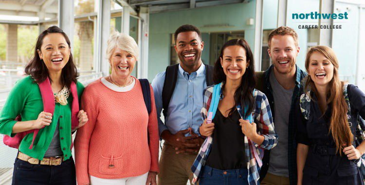 cheerful adult students hanging out in school