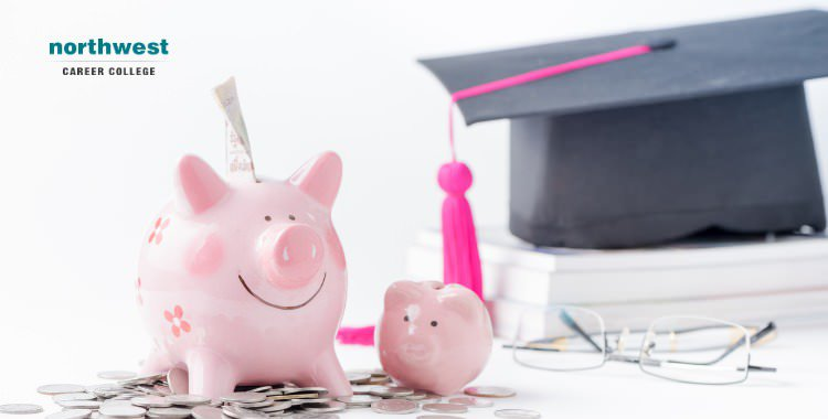 A piggy bank on top of coins with glasses and graduation cap in the background.