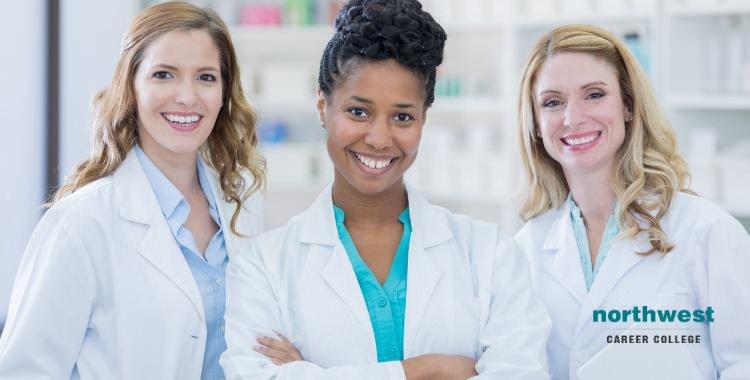 medical assistants in medical center smiling.