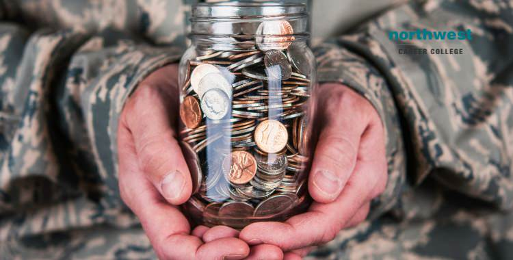military serviceman holding a jar of coins in his hand.