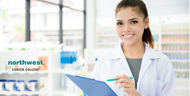 pharmacy technician with a clipboard and pen in hand working in pharmacy