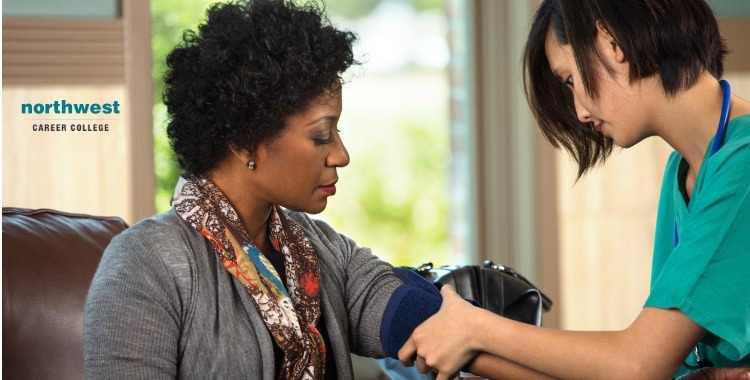 A medical assistant measuring blood pressure of a patient