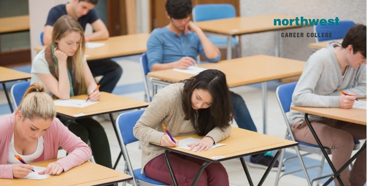 students writing exam hall