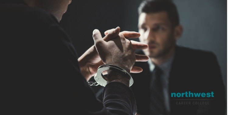 criminal man-with-handcuffs-being-interviewed by Probation Officer