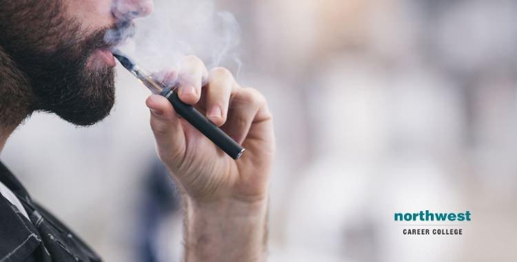 male smoking electronic cigarette
