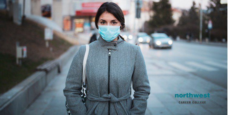 young woman with face mask on the street