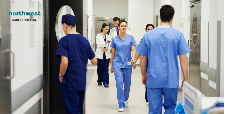 doctors and stuff walking through corridor in hospital