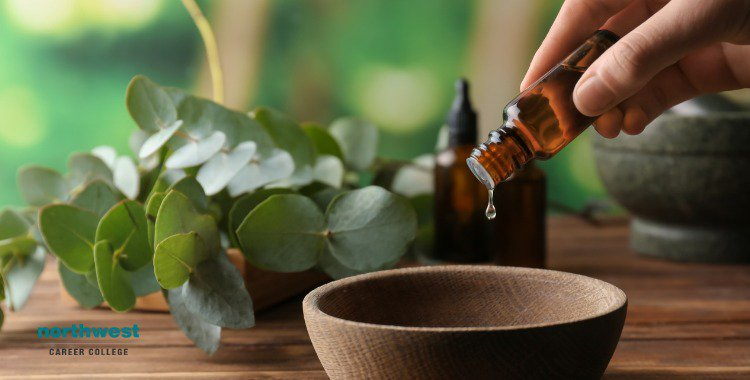 essential oils into bowl on wooden table