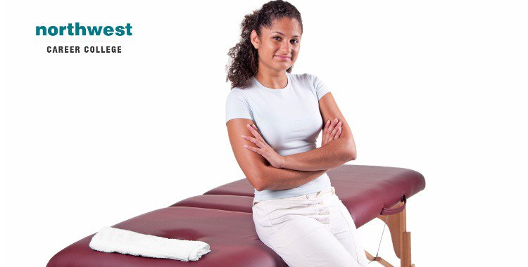 massage table with proud massage therapist