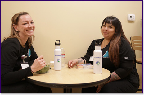 NCC students eating with go green water bottles